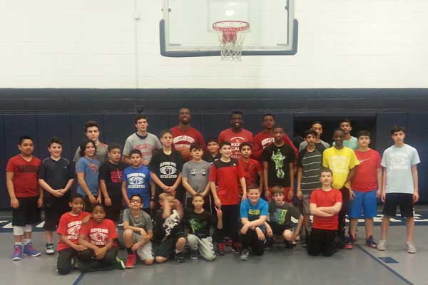 Montclair University basketball players with Elmwood Park Recreation basketball players
